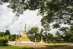 Golden pagoda mixed arts Thailand - Burma in in Thai temple. Royalty Free Stock Images