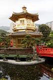 Golden Pagoda, Nan Lian Garden. Golden Pagoda and red bridge in Nan Lian gardens, Kowloon, Hong Kong, known as the Pavilion of Absolute Perfection stock photo