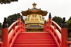Golden Pagoda, Nan Lian Garden. Golden Pagoda and red bridge in Nan Lian gardens, Kowloon, Hong Kong, known as the Pavilion of Absolute Perfection stock photos