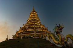 Golden Pagoda nine tier with dragon texture at Chinese temple - wat hyua pla kang temple , Chiang Rai. Royalty Free Stock Images