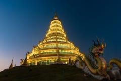Golden Pagoda nine tier with dragon texture at Chinese temple - wat hyua pla kang temple , Chiang Rai. Stock Image