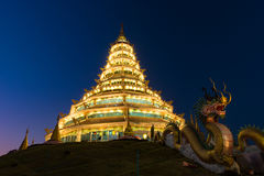 Golden Pagoda nine tier with dragon texture at Chinese temple - wat hyua pla kang temple , Chiang Rai. Stock Photography