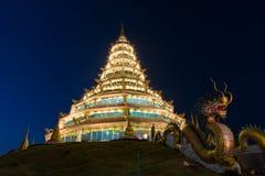 Golden Pagoda nine tier with dragon texture at Chinese temple - wat hyua pla kang temple , Chiang Rai. Royalty Free Stock Photography