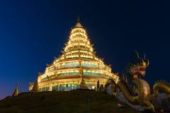 Golden Pagoda nine tier with dragon texture at Chinese temple - wat hyua pla kang temple , Chiang Rai. Stock Images