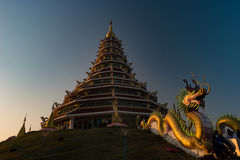 Golden Pagoda nine tier with dragon texture at Chinese temple - wat hyua pla kang temple , Chiang Rai. Royalty Free Stock Photography