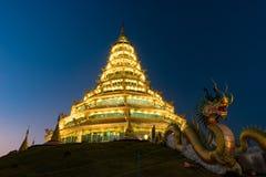 Golden Pagoda nine tier with dragon texture at Chinese temple - wat hyua pla kang temple , Chiang Rai. Stock Photo