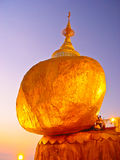 GOLDEN PAGODA PEOPLE PRAYING ROCK TWILIGHT Royalty Free Stock Photos