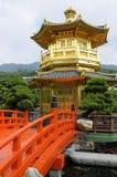 Golden Pagoda, red bridge, Chinese garden, Hong Kong. Golden Pagoda with red bridge in Nan Lian gardens, Kowloon City, Hong Kong Royalty Free Stock Image