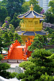 Golden Pagoda, red bridge and Chinese garden, Kowloon, Hong Kong, vertical. Golden Pagoda and red bridge in Nan Lian gardens, Kowloon, Hong Kong, known as the Royalty Free Stock Photography