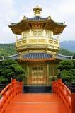 Golden Pagoda with red bridge, kowloon, hong kong, china. Golden Pagoda with red bridge in Nan Lian gardens, Kowloon City, Hong Kong, known as the Pavilion of Royalty Free Stock Image