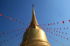 Golden pagoda with red flag of buddhism spell Royalty Free Stock Photography