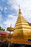 Golden Pagoda from  -The royal temple- Wat Phra That Cho Hae, Phrae, Thailand. With blue sky Stock Photo