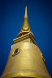 Golden pagoda on the sky background, thailand Royalty Free Stock Image