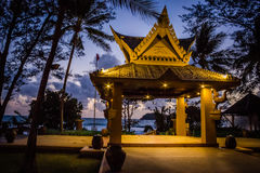 Golden Pagoda. The Golden Pagoda at sunset in the gardens of Kata Beach Resort Hotel - Phuket Stock Images
