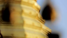 Golden pagoda temple bell shifting focus stock footage