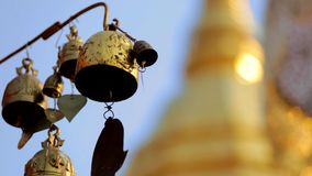Golden pagoda temple bell stock footage