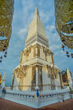 Golden pagoda and temple at Tra Uthen,Nakorn Phanom;Thailand. Golden pagoda and temple at Tra Uthen,Nakorn Phanom;Thailand with blue sky Royalty Free Stock Image
