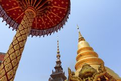 Golden Pagoda in Thai Public Royal Temple with Blue Sky. Stock Photography