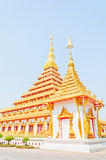 Golden pagoda at the Thai temple, Khonkaen Thailand. The Golden pagoda at the Thai temple, Khonkaen Thailand Royalty Free Stock Images