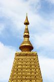 Golden Pagoda in Thailand. On blue sky background Stock Image