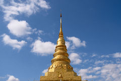 Golden pagoda in thailand with blue sky. Thai architecture at Wat chae Hang , Nan , Thailand Royalty Free Stock Photography