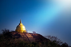 Golden pagoda top on the moutain in Bung Kong Long Stock Photo