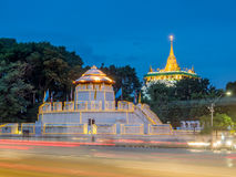 Golden pagoda with traffic light movement. Golden mountain pagoda and old style fortress decorated with light bulb with night light traffic movement under Royalty Free Stock Images