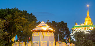 Golden pagoda with traffic light movement. Golden mountain pagoda and old style fortress decorated with light bulb with night light traffic movement under Royalty Free Stock Image