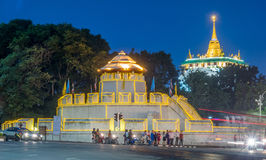 Golden pagoda with traffic light movement. Golden mountain pagoda and old style fortress decorated with light bulb with night light traffic movement under Royalty Free Stock Photography