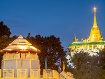 Golden pagoda with traffic light movement Royalty Free Stock Images