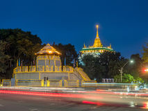 Golden pagoda with traffic light movement Stock Photos