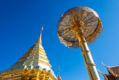 Golden pagoda and umbrella Stock Image