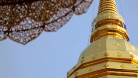 Golden pagoda umbrella temple stock footage
