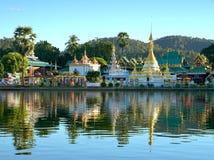 Golden pagoda of Wat Chong Klang and Wat Chong Kham with reflect Stock Photos