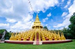 Golden pagoda at Wat pa sawang boon temple. Royalty Free Stock Photography