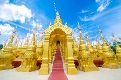 Golden pagoda at Wat pa sawang boon temple Thailand Royalty Free Stock Images