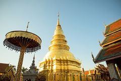 A golden pagoda at Wat Phra That Hariphunchai. The most important buddhist landmark in Lumphun city, Northern Thialand Royalty Free Stock Image