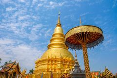 A golden pagoda at Wat Phra That Hariphunchai. The most important buddhist landmark in Lumphun city, Northern Thialand Royalty Free Stock Photography