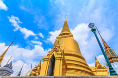 Golden pagoda at Wat Phra Kaew in landscape view. Bangkok's most famous landmark was built 1782. Within the palace complex are several impressive buildings Stock Photography