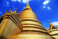 Golden pagoda of Wat Phra Kaew in Thailand. Gold trimmed with sky Beautiful architecture of Thailand Stock Photography