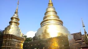 Golden pagoda in Wat Phra Singh Buddhist temple at Chiang Mai, Thailand. Golden pagoda in Wat Phra Singh Buddhist temple at Chiang Mai, Thailand stock footage