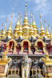 Golden pagoda at Wat Phra That Su Thon Mongkhon Khiri Samakkhi Stock Photo