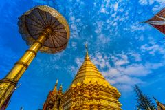 Golden pagoda in wat Phrathat Doi Suthep  Chiang Mai. Golden pagoda in wat Phrathat Doi Suthep under blue sky.Temple is tourist attraction of Chiang Mai Royalty Free Stock Photos