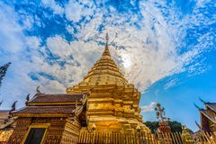 Golden pagoda in wat Phrathat Doi Suthep  Chiang Mai. Golden pagoda in wat Phrathat Doi Suthep under blue sky.Temple is tourist attraction of Chiang Mai Royalty Free Stock Images