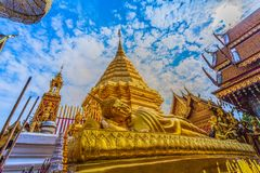 Golden pagoda in wat Phrathat Doi Suthep  Chiang Mai. Golden pagoda in wat Phrathat Doi Suthep under blue sky.Temple is tourist attraction of Chiang Mai Royalty Free Stock Photo