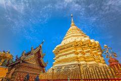 Golden pagoda in wat Phrathat Doi Suthep  Chiang Mai. Golden pagoda in wat Phrathat Doi Suthep under blue sky.Temple is tourist attraction of Chiang Mai Stock Images