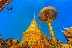 Golden pagoda in wat Phrathat Doi Suthep  Chiang Mai. Golden pagoda in wat Phrathat Doi Suthep under blue sky.Temple is tourist attraction of Chiang Mai Stock Photography