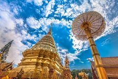 Golden pagoda in wat Phrathat Doi Suthep  Chiang Mai. Golden pagoda in wat Phrathat Doi Suthep under blue sky.Temple is tourist attraction of Chiang Mai Stock Photos