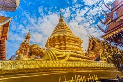 Golden pagoda in wat Phrathat Doi Suthep  Chiang Mai. Golden pagoda in wat Phrathat Doi Suthep under blue sky.Temple is tourist attraction of Chiang Mai Stock Image
