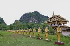Golden Pagoda At Wat Sao Roi ton in Payatongsu, Myanmar. Near Thailand and Myanmar Border Crossing Points with true nature and mountain view Royalty Free Stock Images